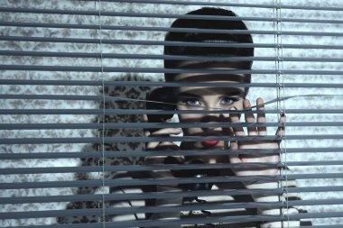 jalousie woman near window