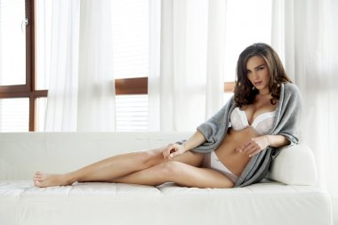 Beautiful and sexy woman in lingerie and sweater