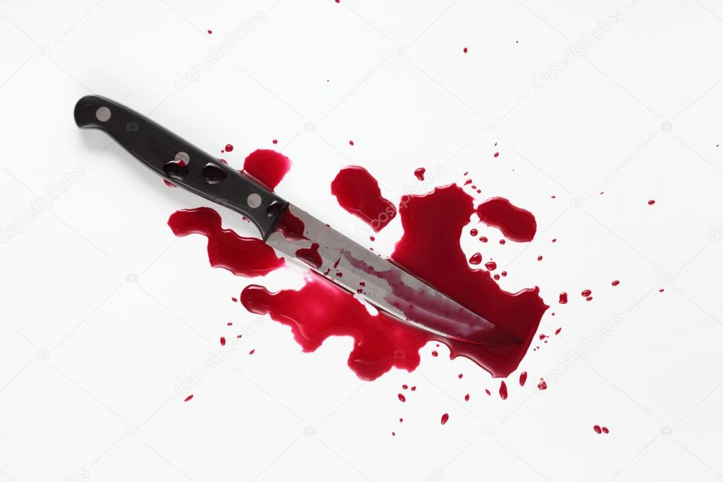 Bloody knife with blood splatter isolated on white.