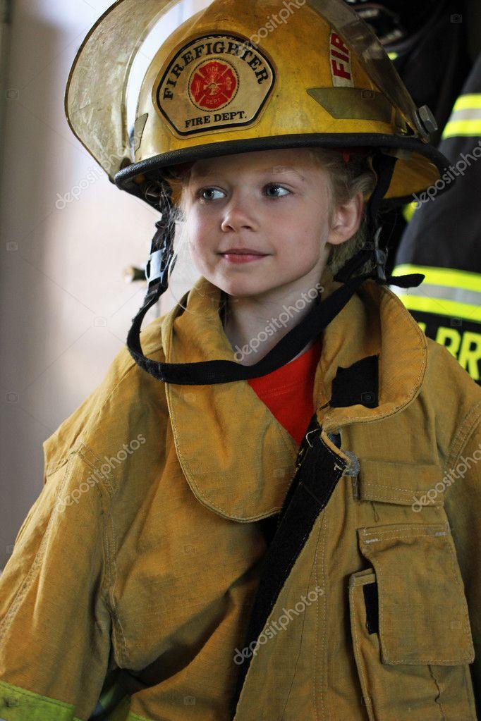 Young girl in fireman gear