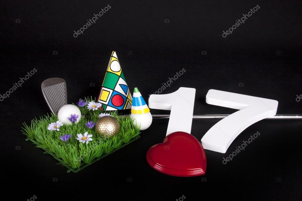 A golf club and golf ball on an artificial peace of grass to be used as a birthday card