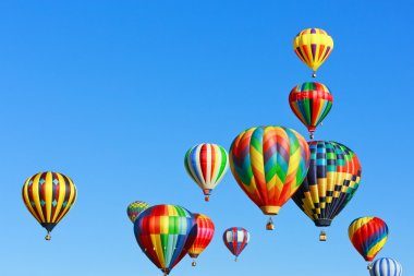Colorful hot air balloons against blue sky stock vector