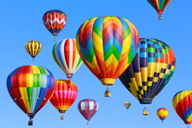 Colorful hot air balloons over blue sky stock vector