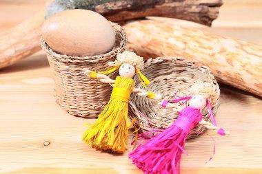 still-life with straw dolls
