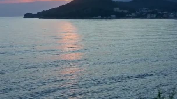 Pink sunset and coastline (Albania)