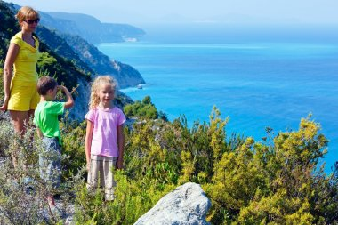 Family and Lefkada Island coast (Greece)