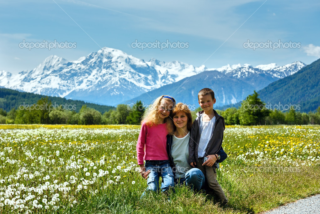 Summer dandelion meadow and family (Italy).