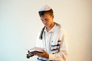 Young Jewish man does prayers .