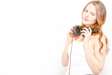 Goregous young woman holds headphones