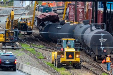 Train Cars Carrying Oil Derailed
