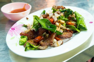 Delicious food in Northeast of Thailand made from deep fried pork, chili, garlic and basil