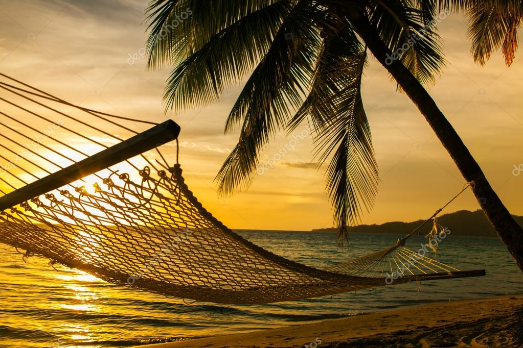 Фотообои Hammock silhouette with palm trees on a beach at sunset