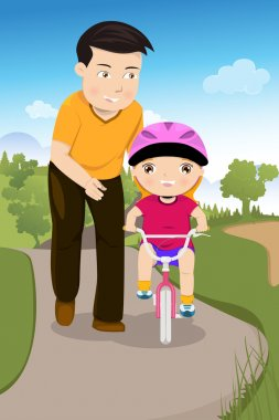 Father teaching his daughter riding a bike
