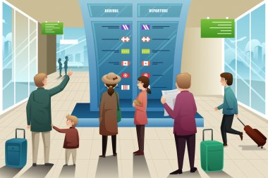 Travelers looking at departure board