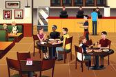 mladí lidé jíst pizzu v restauraci