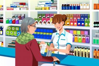 Pharmacist helping an elderly person