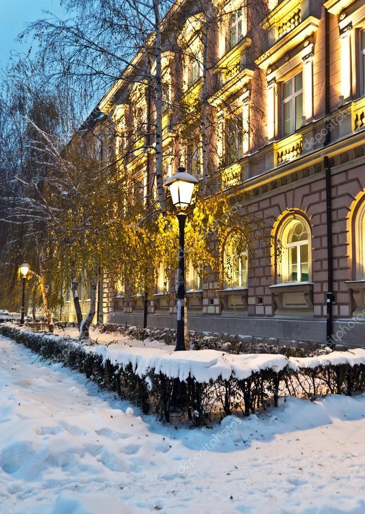 Street covered with snow at night old building at night Zemunska Gimnazija Serbia Belgrade Zemun