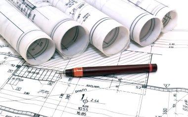 Architect rolls and plans blueprints planning interiors design construction real estate