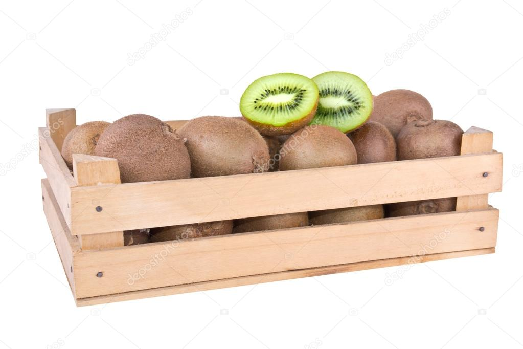 Kiwi Fruit And Some Cut Ones In A Wooden Box Crate Stock Photo