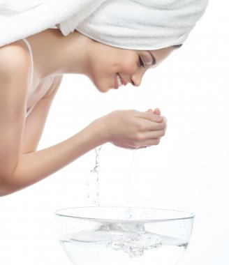 Woman is washing her face