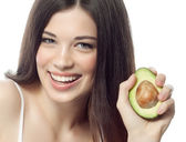 Smiling woman with with avocado