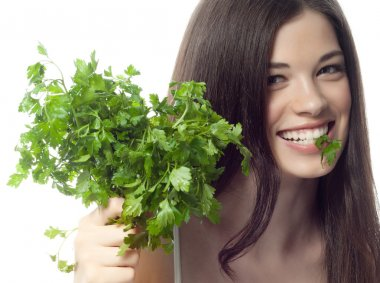 Smiling woman with parsley
