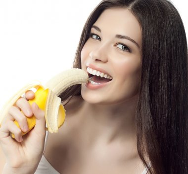 Smiling woman with bananas