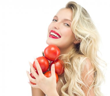 Smiling woman with tomatos