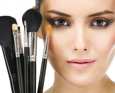Woman with make up brushes