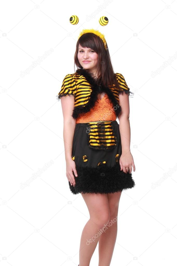 Cheerful young woman dressed bee happy and dancing
