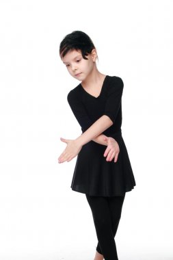 Young ballerina on white background on Beauty and Fashion Beautiful girl in black ballet costume in a dance pose