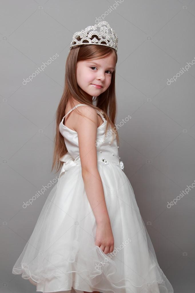 8d363aee39e7 Beautiful little girl in princess dress with long hair on grey background–  stock image
