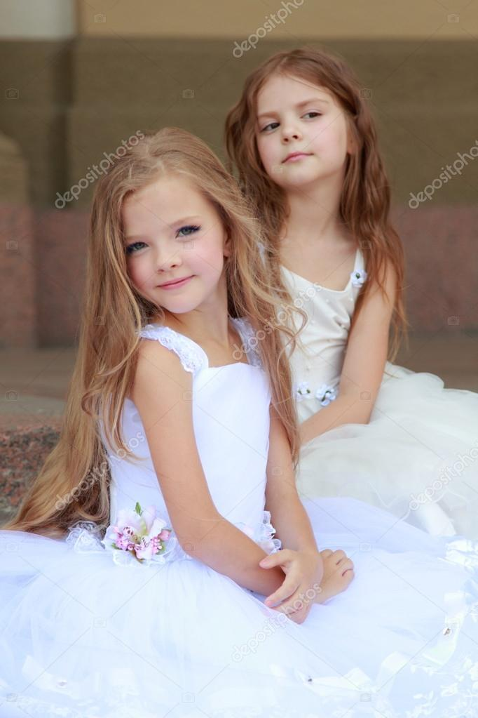 Happy Cute Little Girls With Long Hair In Long White Dresses Sitting On The Steps Stock Photo C Mari1photo 27005921