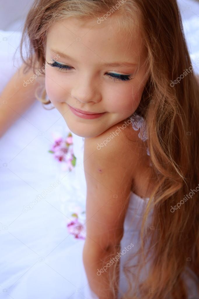 Makeup Ideas makeup for little girls pics : Elegant cute little girl with makeup in a white dress with ...
