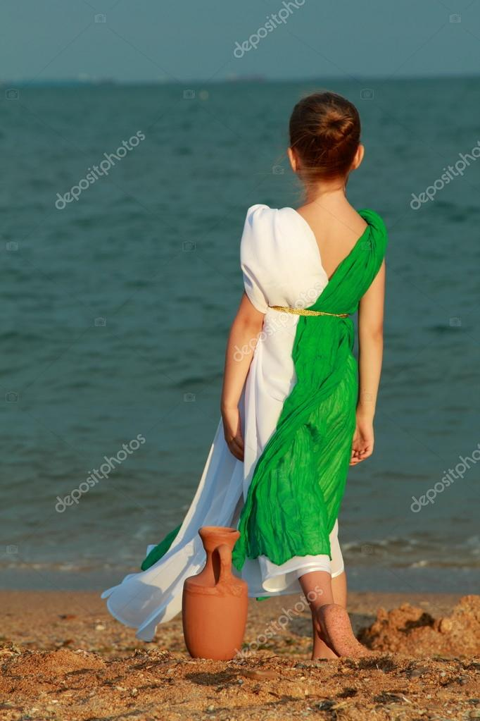 Charming girl in the role of the Roman goddess outdoors