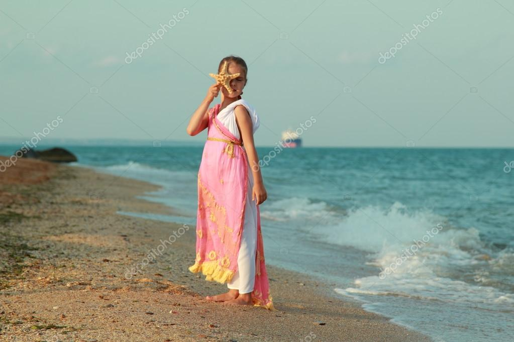 Young girl in a role of the Greek goddess of outdoors