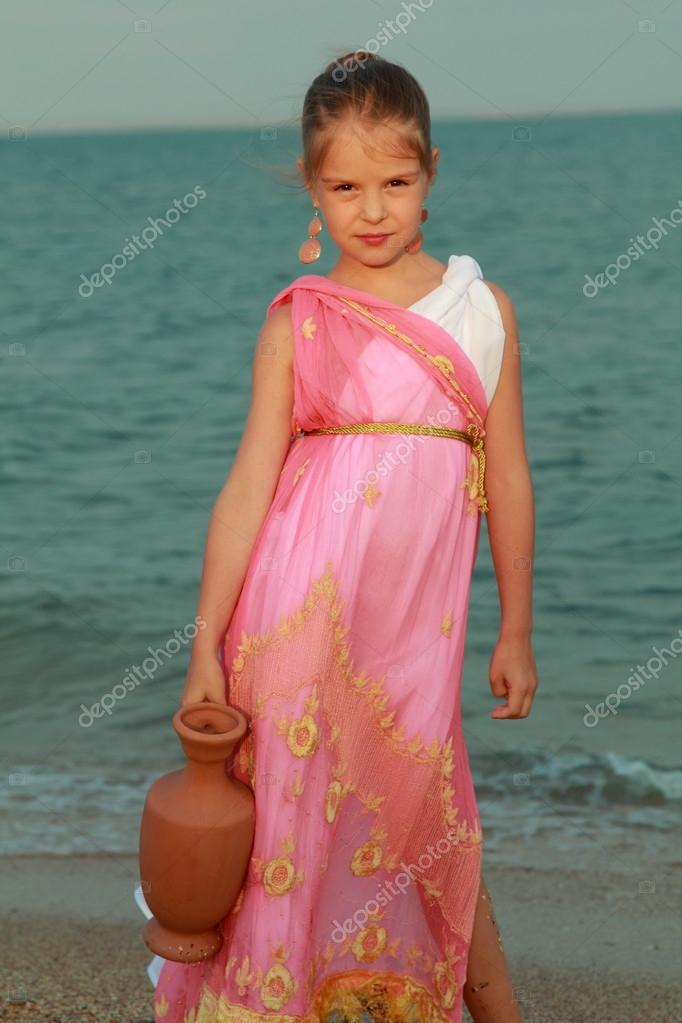 Girl in the role of the Roman goddess outdoors