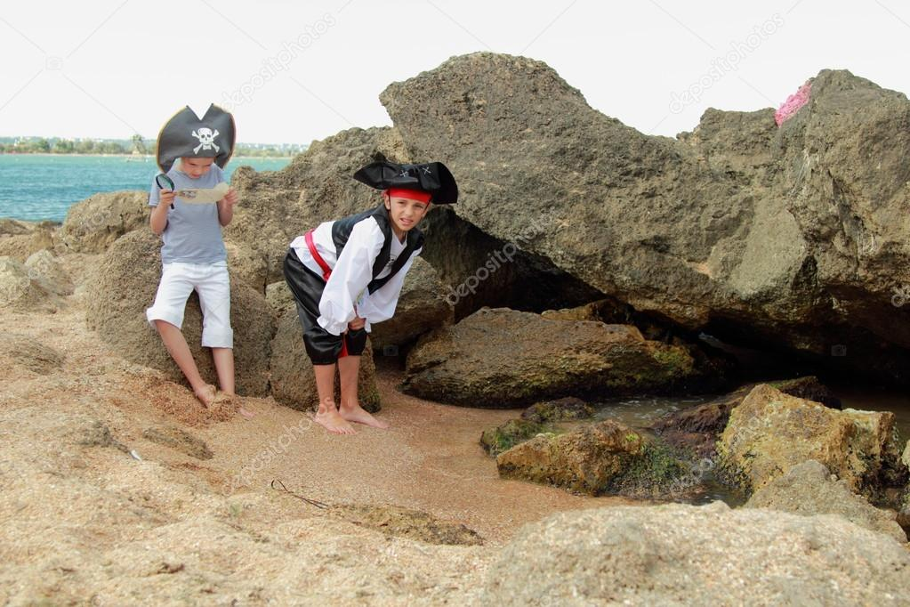 European children smiling boy and girl in fancy dress pirate