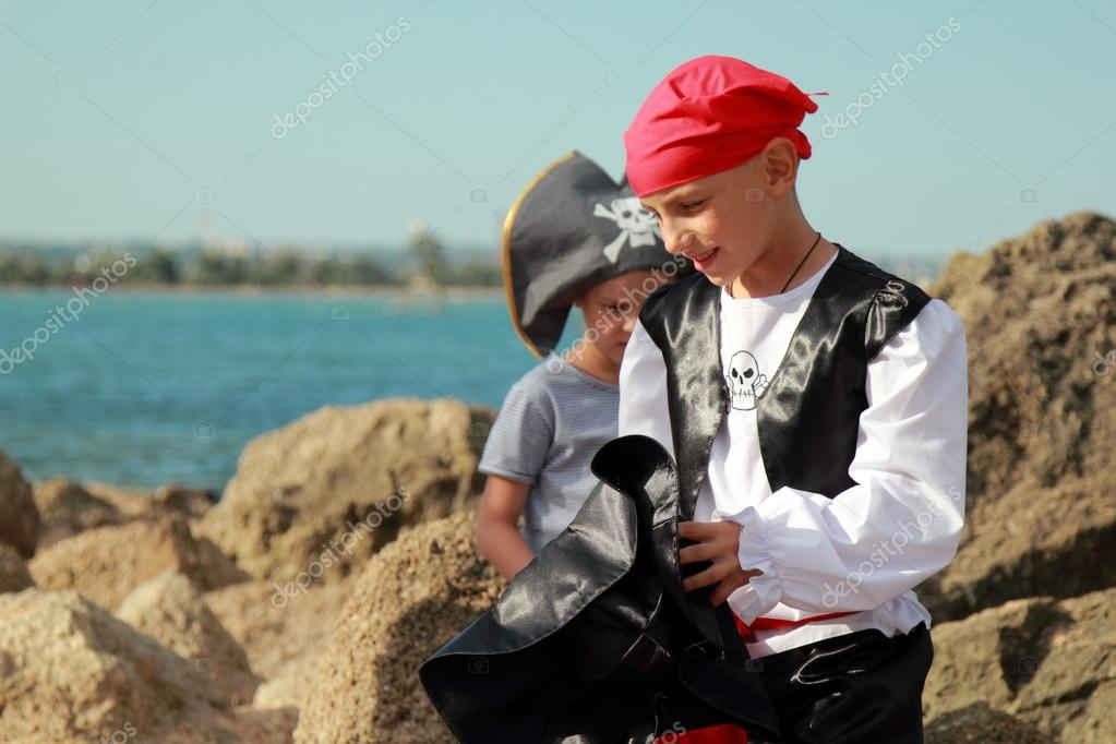 Adorable young boy and girl pirates