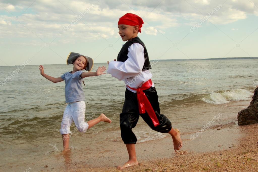 Children playing by the sea pirates