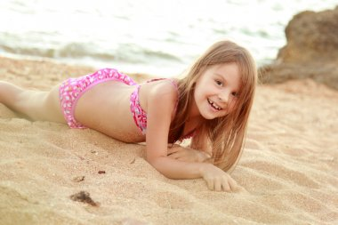 Little cute girl on beach