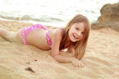 Little cute girl on beach