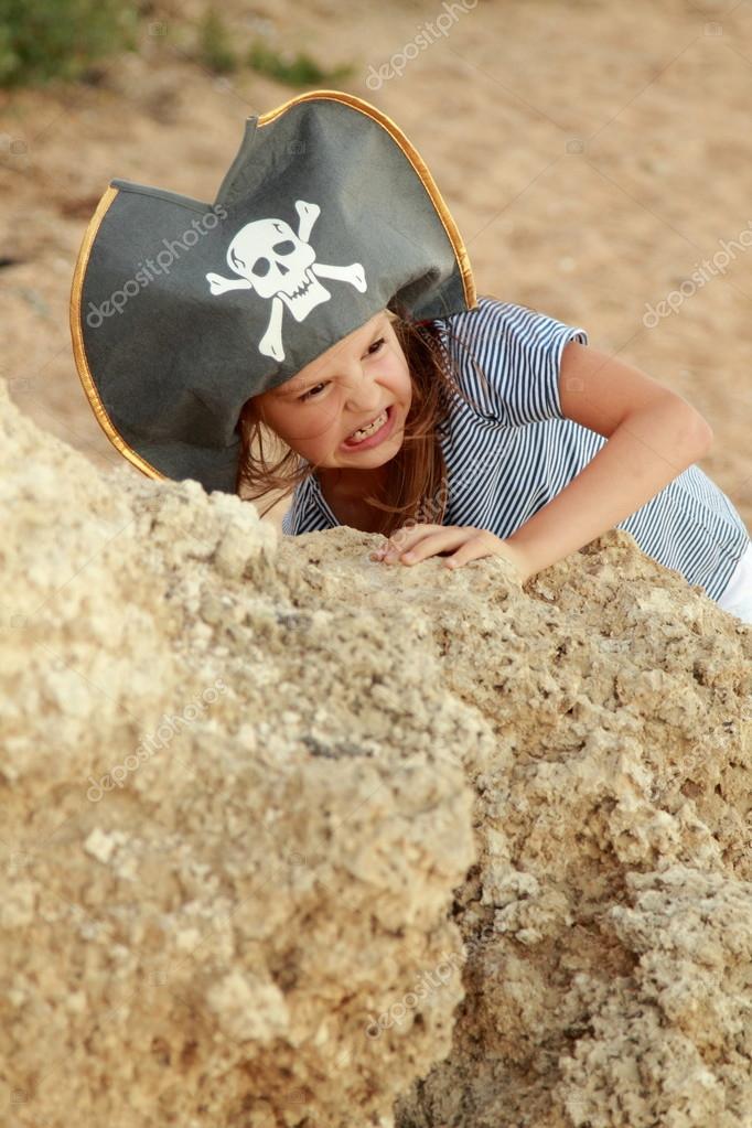 Caucasian emotional little girl in a hat