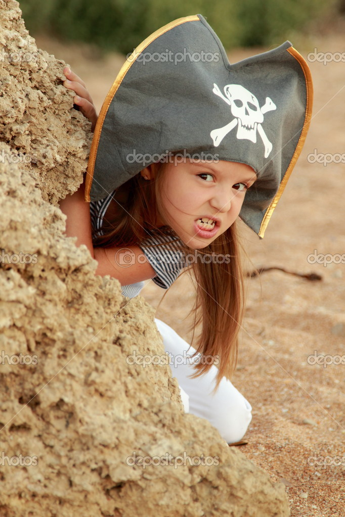 Evil Emotional Young Girl In A Hat With The Symbol Of Piracy Stock