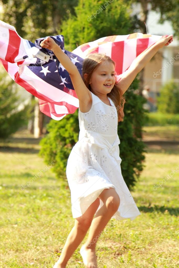 Girl holding a large American flag