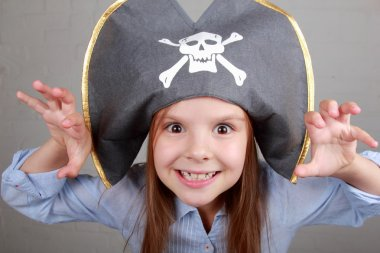 Pirate girl in shirt and hat