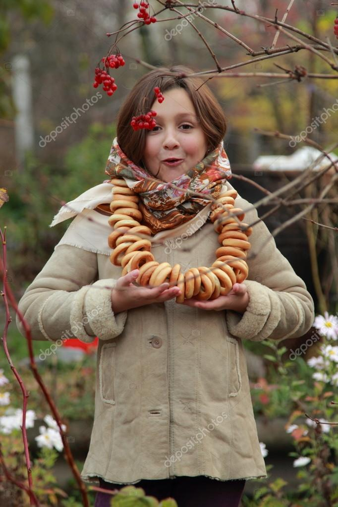 Girl in russian village traditional kerchief