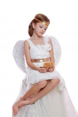 Little angel holding angel doll