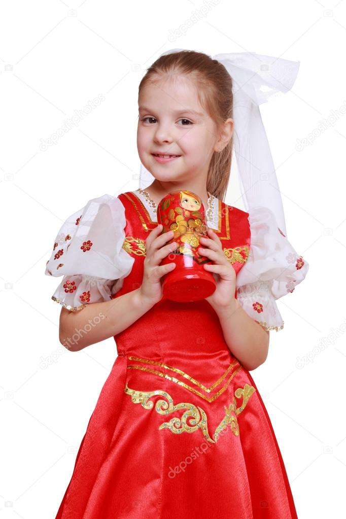 Girl holding doll in tradition style