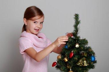 Little girl near the Cristmas tree